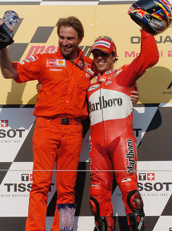 Podium: race winner Loris Capirossi celebrates with Livio Suppo