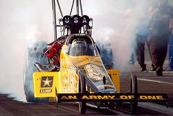 Tony Schumacher does a smoky burn-out