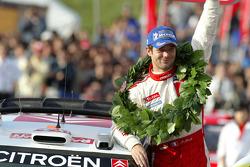 Podium: 2005 WRC champion Sébastien Loeb celebrates