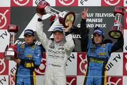 Podium: race winner Kimi Raikkonen with Giancarlo Fisichella and Fernando Alonso