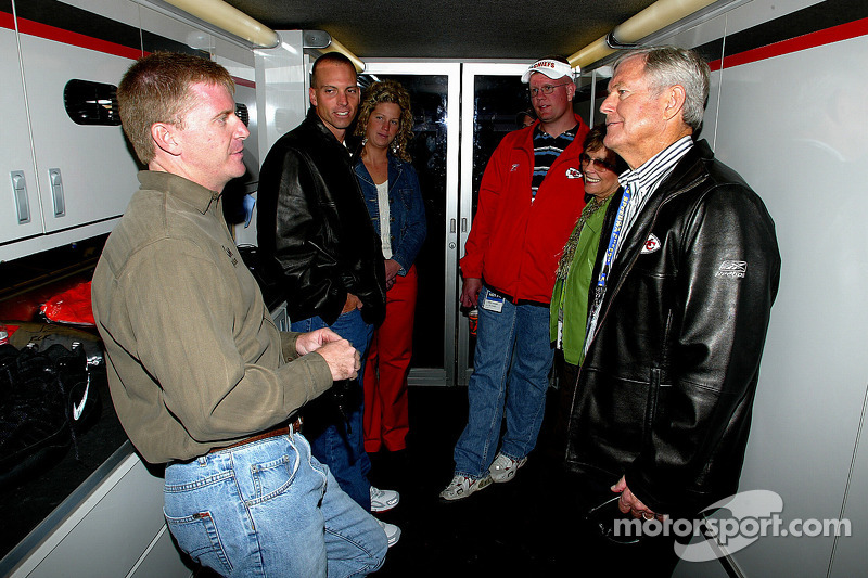 Jeff Burton talks with Kansas City Chiefs coach Dick Vermeil and his wife