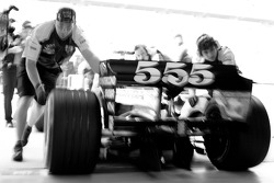 BAR-Honda team members push the car back into the garage