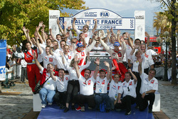 Podium: rally winners Sébastien Loeb and Daniel Elena celebrate with Citroën Sport team members