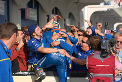 Race winner Marco Melandri celebrates with his team
