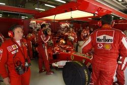 Michael Schumacher back in the garage after his crash