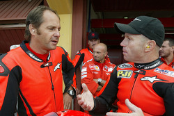 Gerhard Berger rides the Ducati MotoGP Desmosedici with Randy Mamola