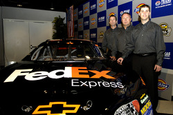Denny Hamlin with team president J.D. Gibbs and vice president Jimmy Makar, announce Hamlin as the driver of the #11 FedEx Chevrolet