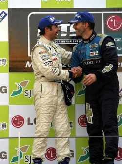 Podium: Andy Priaulx and Alain Menu