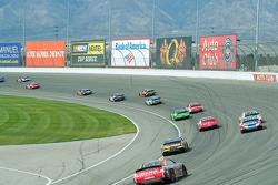 Cars race through Turn 1