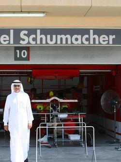A local visitor looks into Ferrari garage area