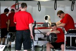 Super Aguri F1 team members at work