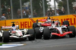Jenson Button and Kimi Raikkonen battle