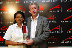 (L-R): Dana Cooper (RSA) CEO A1 Team South Africa and David Clare (GBR) Chief Operating Officer A1 GP with the award for best presented event