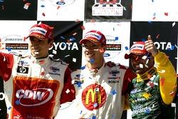 Podium: race winner Sébastien Bourdais with Justin Wilson and Alex Tagliani