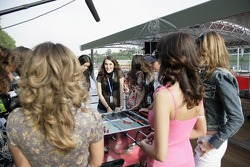 Chilled Thursday: the Formula Unas girls girls in the Red Bull Energy Station playing tabletop soccer with Scott Speed