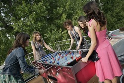Jeudi refroidi: the Formula Unas girls in the Red Bull Energy Station playing tabletop soccer