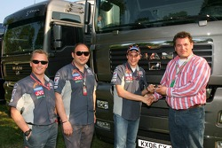Johnny Herbert, Midland MF1 Racing, Sporting Relations Manager with Colin Kolles, Midland MF1 Racing, Team Principal, Christijan Albers, Midland MF1 Racing and The General Director of MAN Truck and bus b.v Bert van Hasselt who hands over the keys to the n
