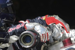 The pitcrew of Red Bull Racing with the fuel nozzle