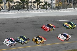 Scott Riggs leads a group of cars