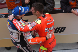 Race winner Marco Melandri celebrates with Casey Stoner