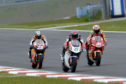 Casey Stoner, LCR Honda; Marco Melandri, Gresini Honda; Dani Pedrosa, Repsol Honda