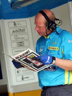 Renault F1 team members reads Red Bulletin