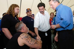 President of NASCAR Mike Helton greets Paul Teutul Sr., Mikey Teutul, Paul Teutul Jr. and Bob Owens during the driver meeting prior to the running of the NASCAR Nextel Cup Series Crown Royal 400