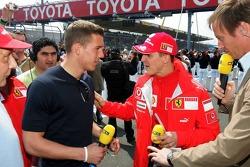 Lukas Podolski and Michael Schumacher