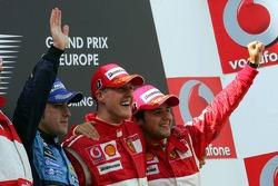 Podium: race winner Michael Schumacher with Fernando Alonso and Felipe Massa