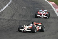 Jenson Button leads Jarno Trulli