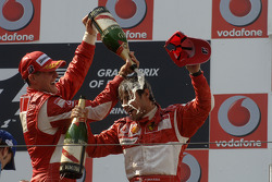 Podium: champagne for Michael Schumacher and Felipe Massa