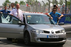 King of Spain Juan Carlos I and Fernando Alonso go for a lap of the circuit in a Renault Megane