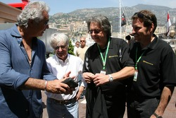 Kangaroo TV gets presented to Bernie Ecclestone and Flavio Briatore by Marc Arseneau