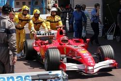 Michael Schumacher pushed to Parc Fermé