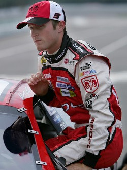 Kasey Kahne climbs out of his car after qualifying