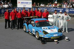 Thorkild Thyrring, Xavier Pompidou, Christian Ried, and the Sebah Automotive Team pose with the Sebah Automotive Porsche 911 GT3 RSR
