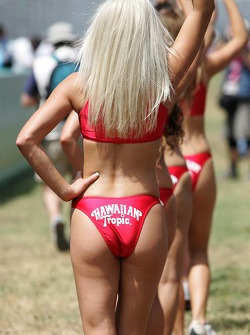The Hawaiian Tropic girls waves to the fans