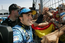 Fernando Alonso goes to meet some of his fans after winning the race