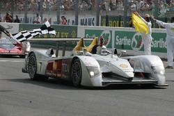 #7 Audi Sport Team Joest Audi R10 takes the checkered flag