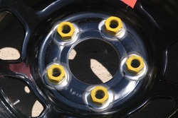 Detail view of lug nuts glued to rims