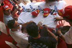 Andreas Zuber, Jose Maria Lopez and Lucas Di Grassi and Alexandre Negrao sign autographs in the Bridgestone tent