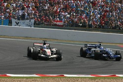 Jenson Button passes Nico Rosberg