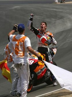 Race winner Nicky Hayden celebrates