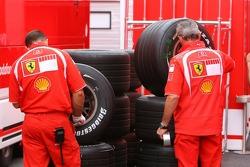 Scuderia Ferrari team members prepare Bridgestone tyres