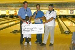 Jeff Gordon Foundation bowling tournament: Jeff Gordon presents a donation to charity