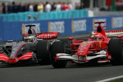 Pedro de la Rosa and Michael Schumacher go side by side