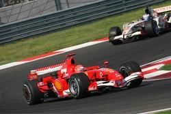 Michael Schumacher leads Jenson Button