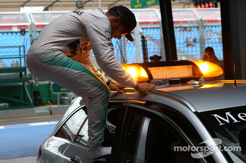 Pole winner Lewis Hamilton, Mercedes AMG F1 jumping out of the medical car