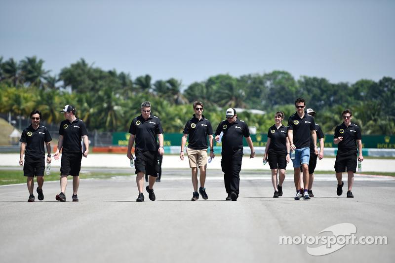 Romain Grosjean, Lotus F1 Team walks the circuit