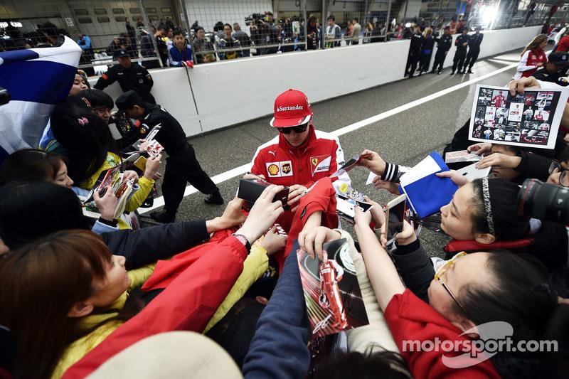 Kimi Raikkonen Ferrari signs autographs for the fans